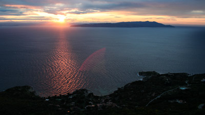View of Giglio Arenella bay at sunrise with view on the Tuscon coast